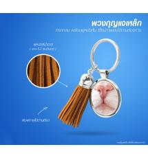 Round iron keychain with short brown leather tassels